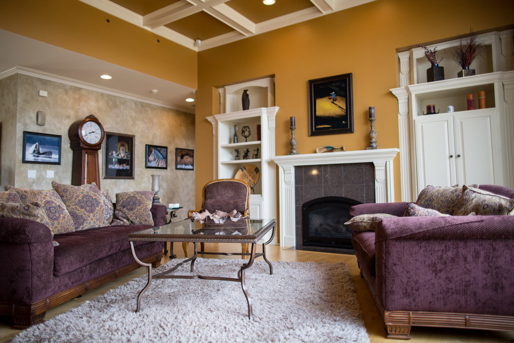 GREAT ROOM with 12 foot coffered ceiling and a wall of windows that will amaze you with the view