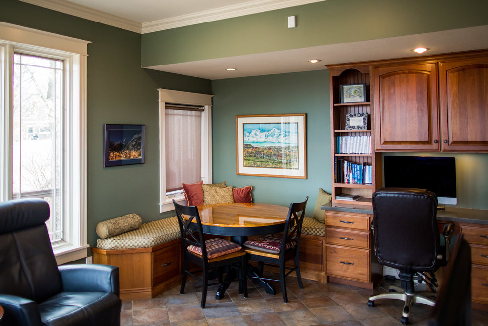BREAKFAST NOOK WITH TABLE, BUILT IN WINDOW SEAT WITH STORAGE, AND DESK AREA