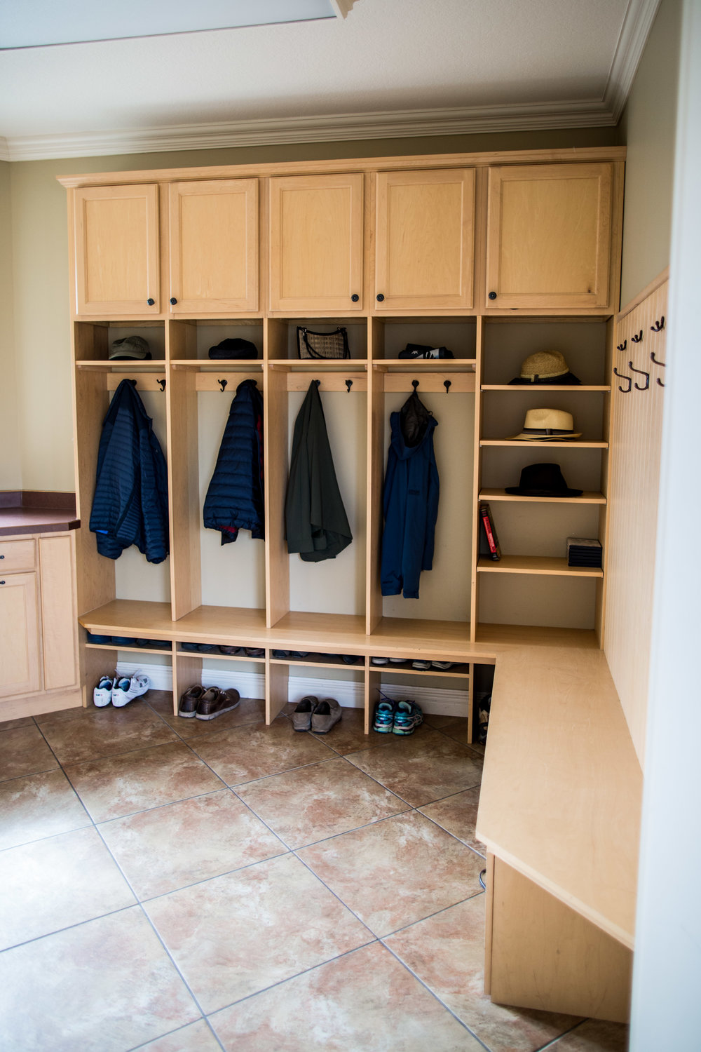 MUDROOM COUNTER, CABINETS AND SMALL CLOSET FOR ALL YOUR STORAGE NEEDS