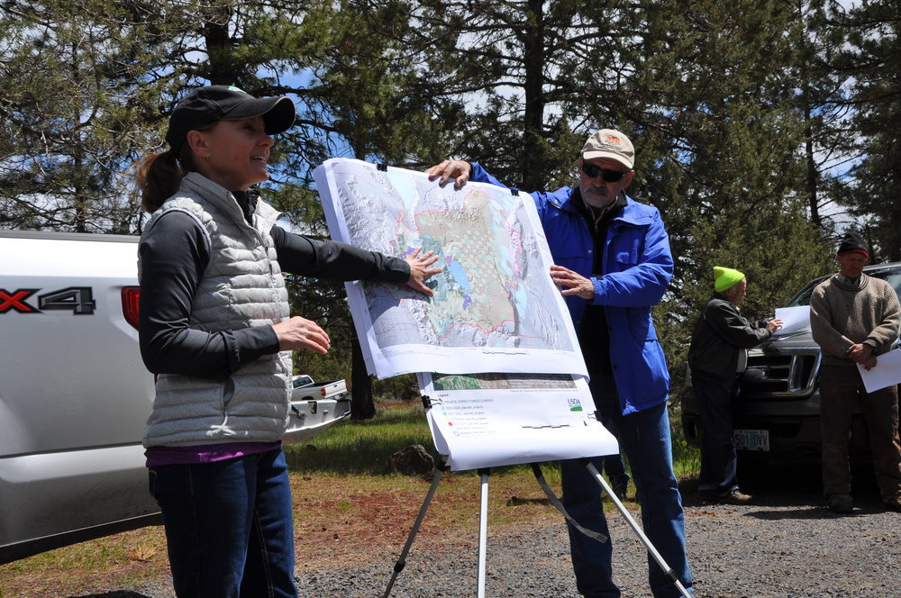 KLFHP Partners Amy Markus (USFS) and Daniel Leavell (OSU KBREC) discuss the North Warner project on a forestry tour May 2017; image courtesy of NRCS Oregon.