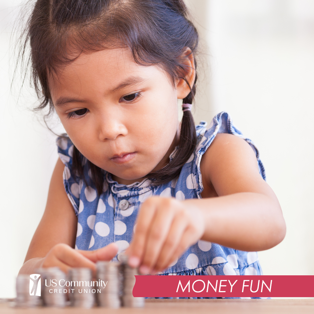 A young girl counting stacks of quarters