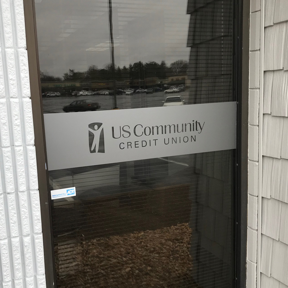New branch remodeling in progress - exterior of a window with the USCCU logo on it
