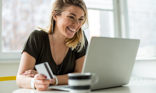 Woman+Making+a+payment+using+card+on+a+laptop.jpg