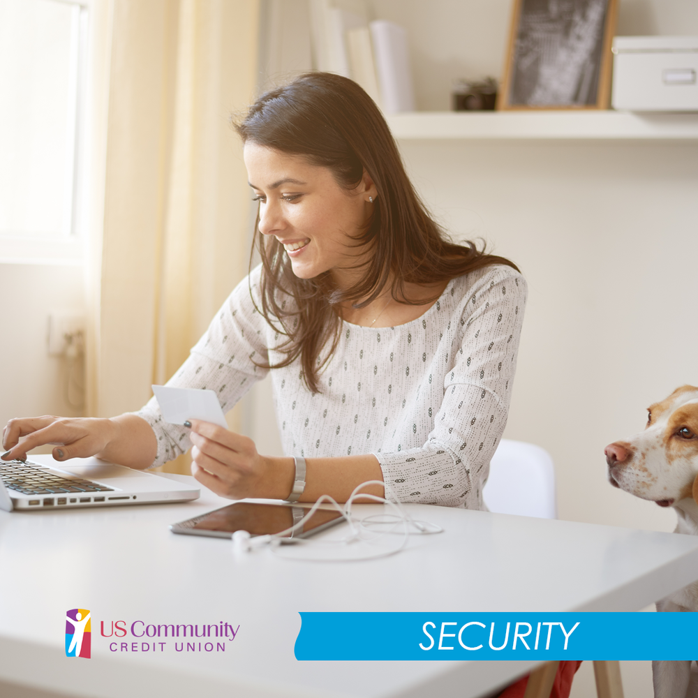 Woman paying her bill online with a dog looking at her.