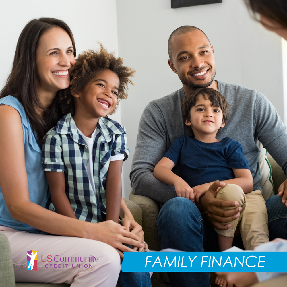 Family of four sitting in a meeting smiling.