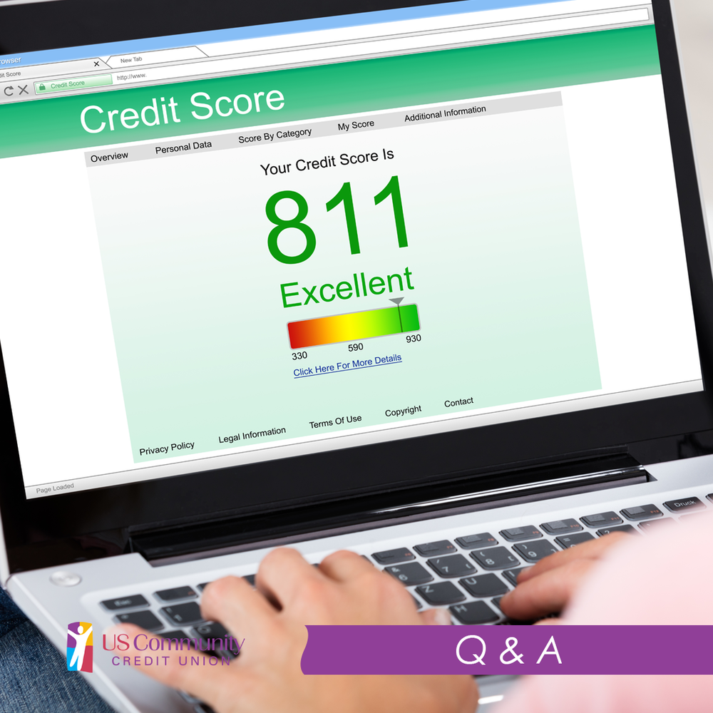 Credit score on a laptop with someone's hands on the keyboard.