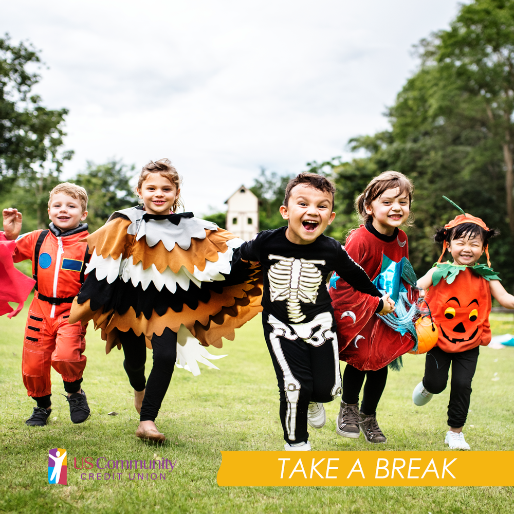 Group of kids running in Halloween costumes.
