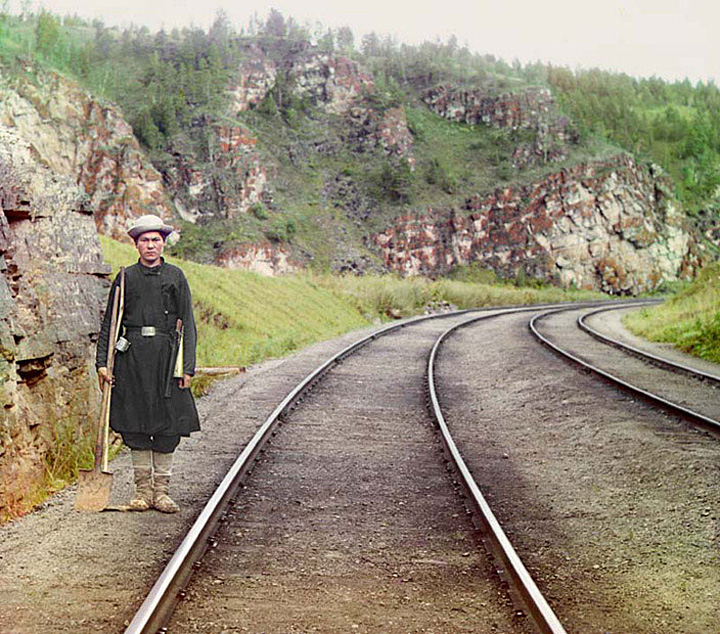 A Bashkir switch operator poses by the mainline of the railroad, near the town of Ust' Katav on the Yuryuzan River between Ufa and Cheliabinsk in the Ural Mountain region of European Russia.