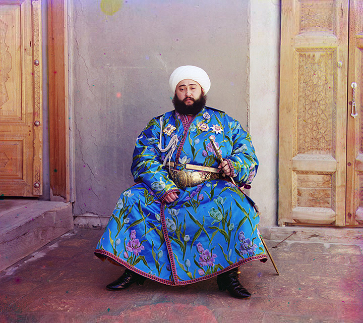 Alim Khan, Emir of Bukhara, seated holding sword. 1905-1915.