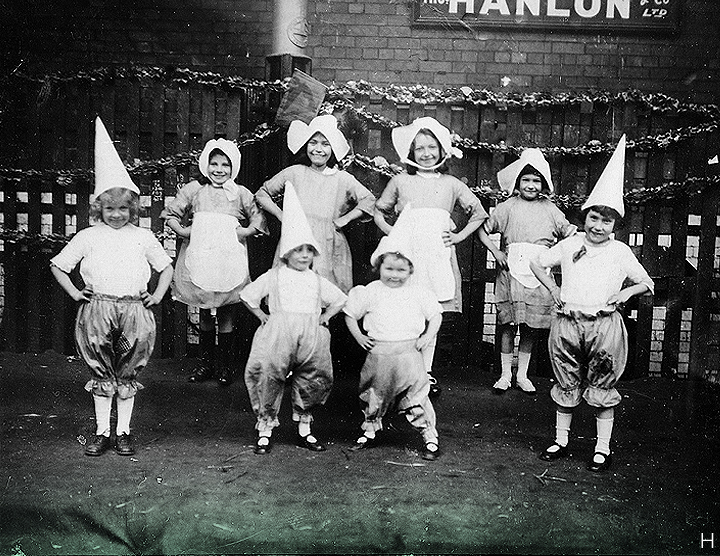 "March 17, 1924 // This happy crew are ""Miss Forde's Children entertaining"". We know this photo was taken in Dublin (perhaps near Smithfield) on St. Patrick's Day."