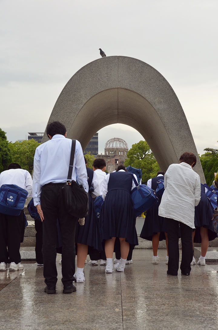 Students bowing in respect at the Hiroshima Memorial Park