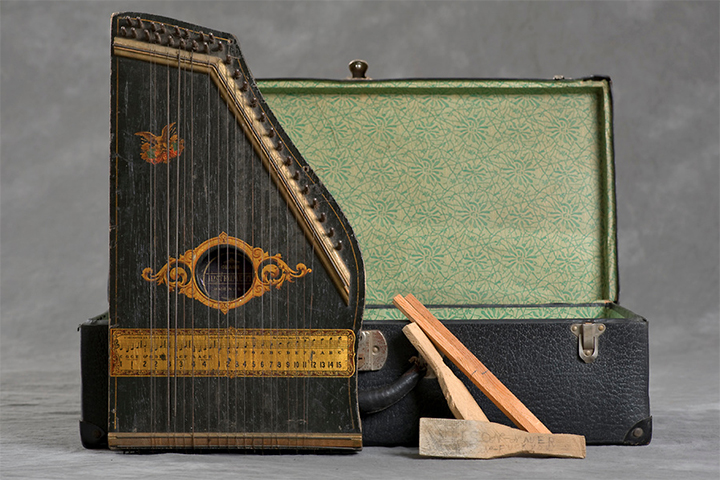 Charles' trunk was the only one that contained a musical instrument.