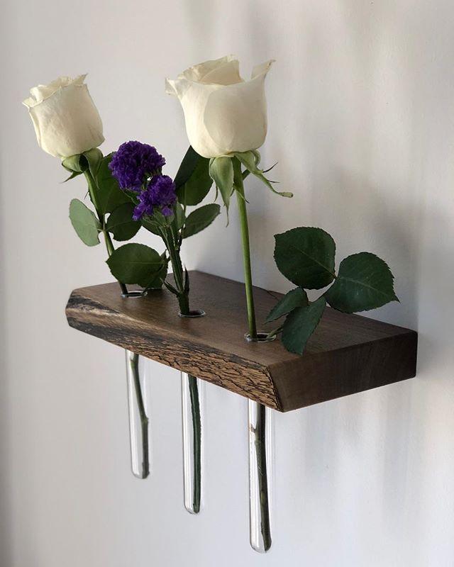 "Live edge floating shelves with test tube ""vases."" Up on Etsy! • #jonmartinwoodworking #jmwoodworking #floatingshelf #flowervase #shelf #liveedge #liveedgeshelf #woodworker #etsy #etsyseller #goteamflourish #carpenter #walldecor #wooddecor"