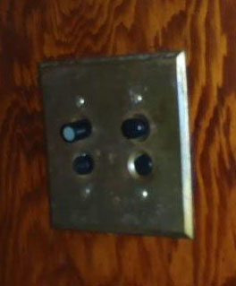 old Duplex push button switch plate photo by Ted Ross