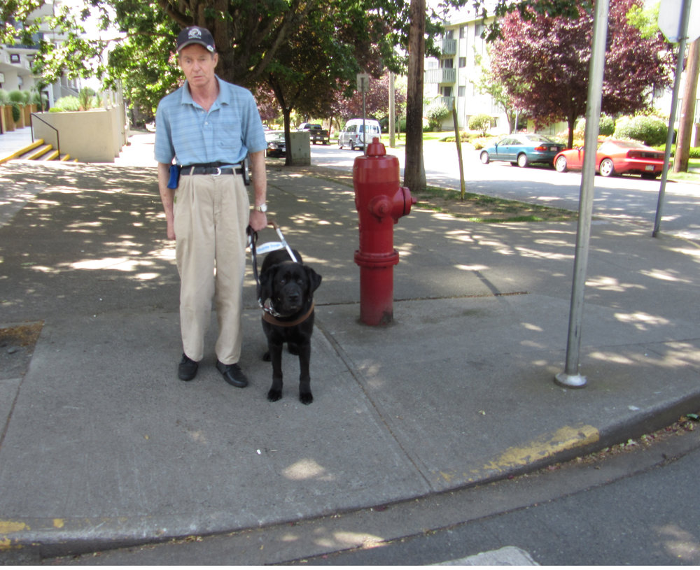 Trevor and Woodie at the corner to cross - photo by trudy chiswell
