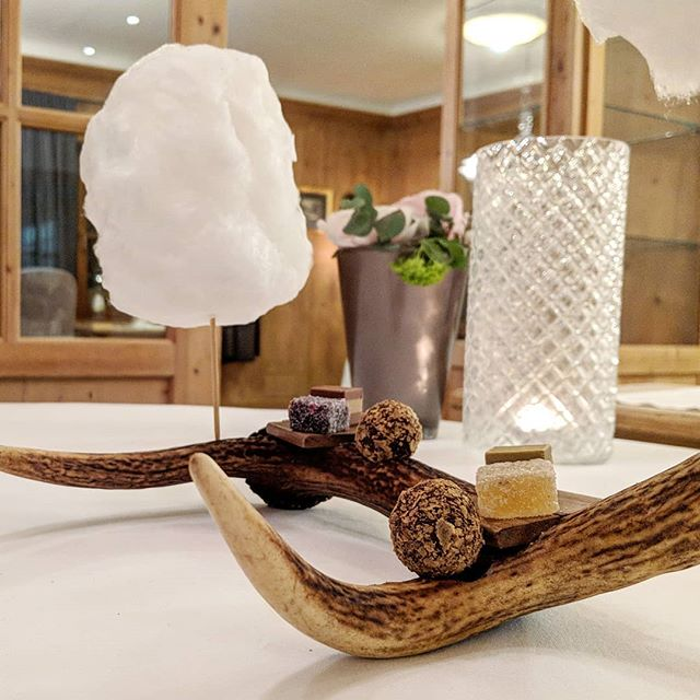 Candyfloss, truffles and ginger; served on...an antler. Awesome experience at St Hubertus #3starmichelin #dessert #southtyrol #food  #travel