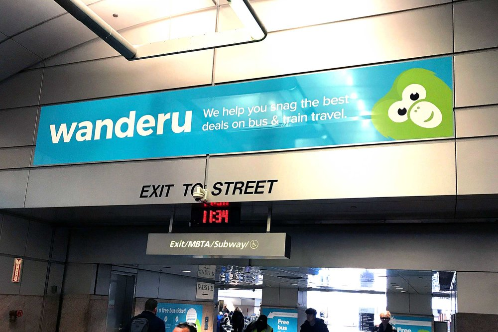 Wanderu South Station takeover campaign • overhead banner design