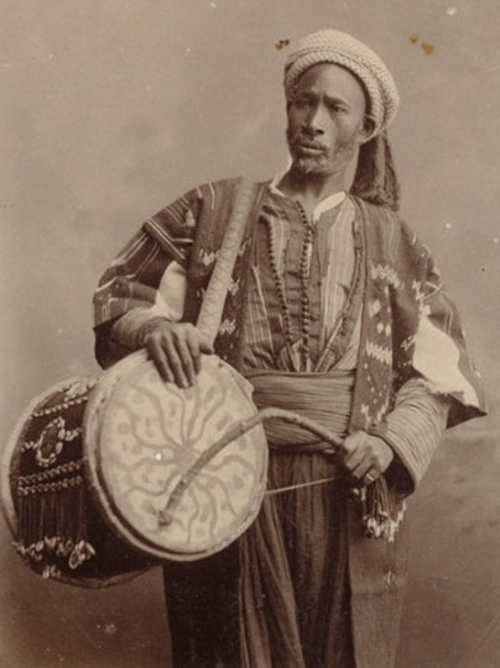 Musician with hennaed drum ( tbal ), Algeria, 1880s. Photograph by William Vaughn Tupper