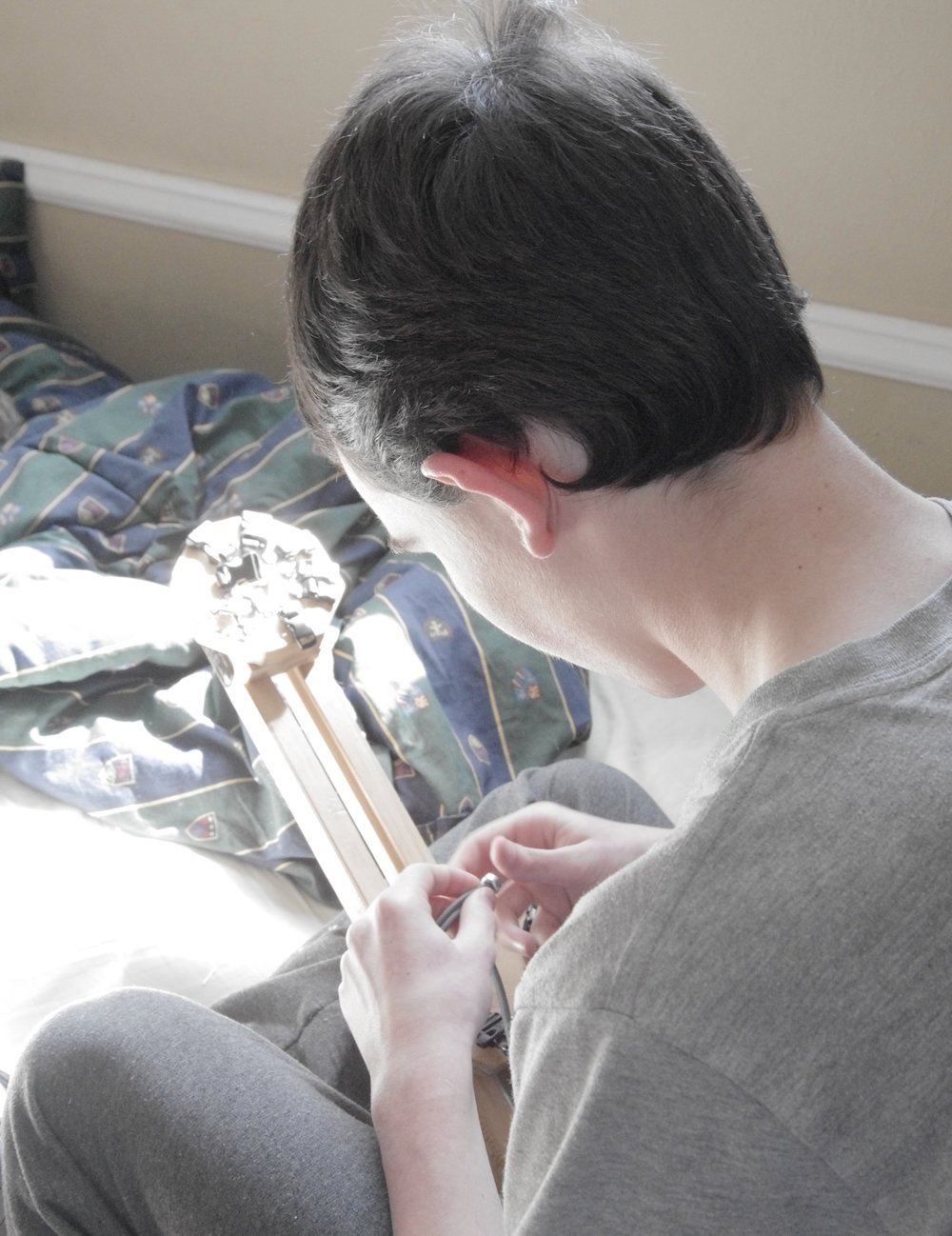 Our oldest son helps to make some of our bracelets. -