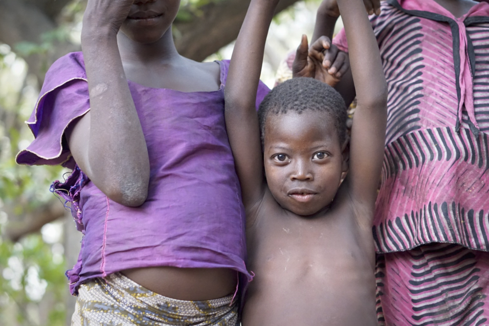 While working in Chad, Africa I had a day off to hike in what they call an enchanted forest. As we entered, there was a large group of children playing. I was able to capture some amazing moments like this because we connected through play instead of just intruders in their home land.