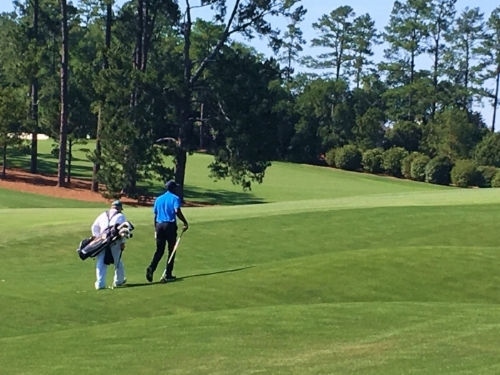Jimmie and Caddie walk up 18th Fairway.JPG