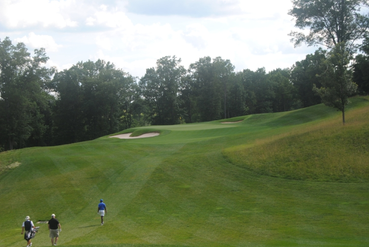Richard, his caddie, and I head to the green on the 11th hole where I started to piece my game back together