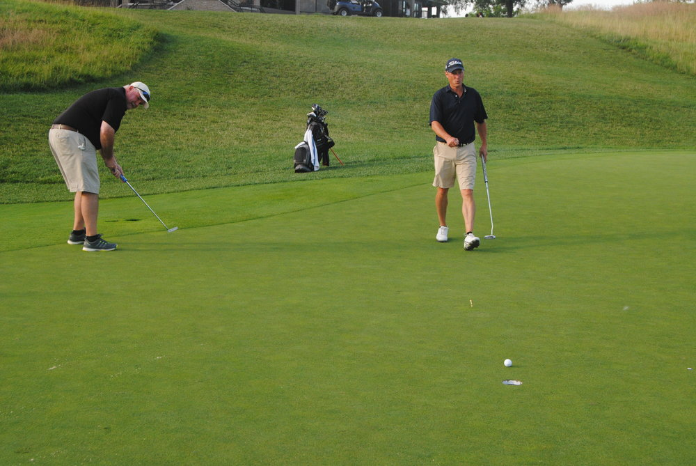 Richard leaves his putt just short of the cup on the 18th green