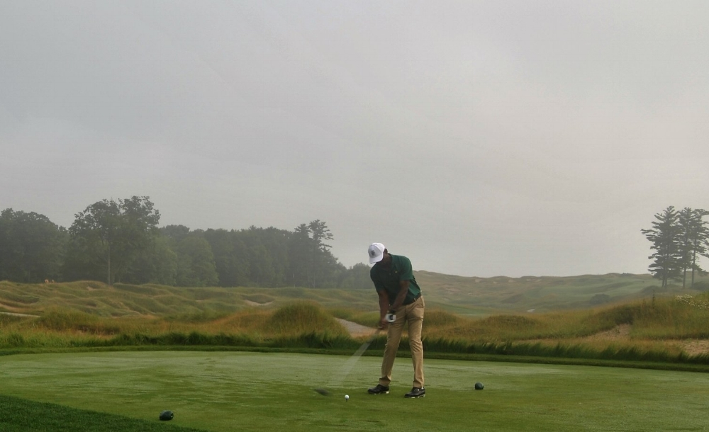 Teeing off on the first hole, into the mist