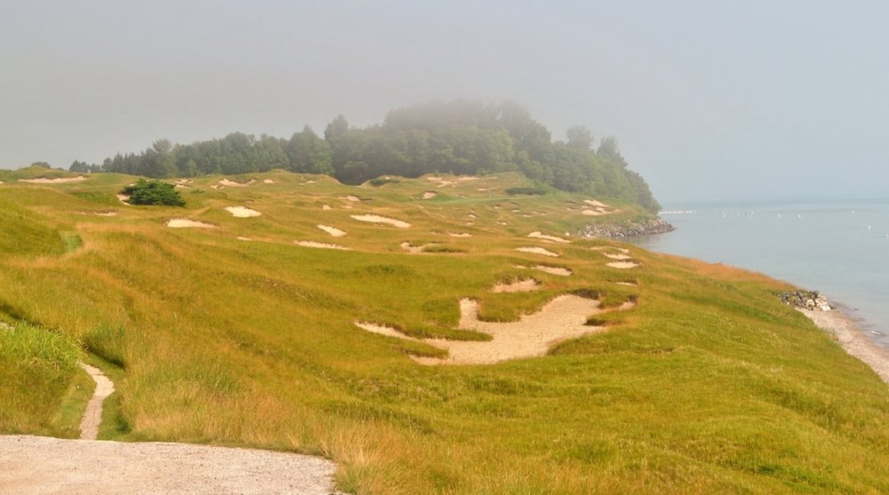 The eighth hole, like the sixth hole, has the fairway on the right and a green that is aligned past all of the fescue and the bunkers that are on the right