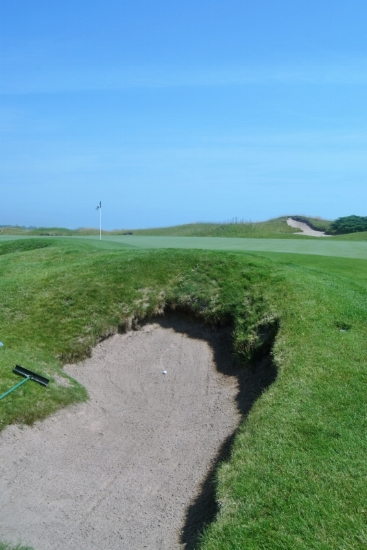 My approach shot need to be hit about a yard to the right to have avoided kicking into the bunker