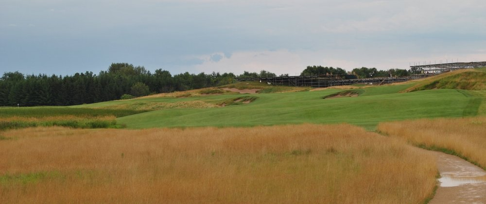 The Par 5 first hole. It doglegs left, the flag is the one on the far left edge of the picture. On the right of the picture there are still remnants of the US Open.
