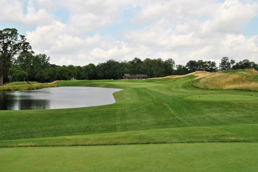 The Par 3 Seventeenth Hole. There is also water to the right of the fescue.