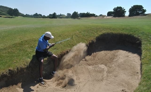 My only viable option as to sit while hitting this sand shot.  If you look very closely you can see the ball in the middle of the sand cloud.