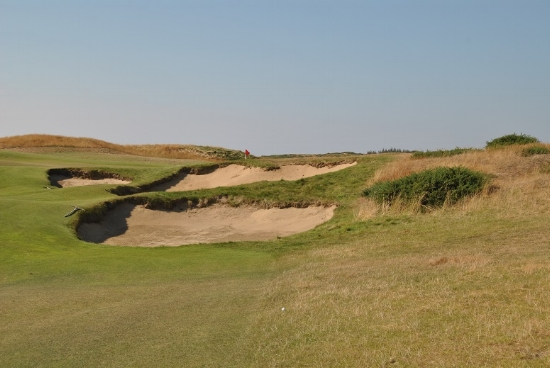 The second shot on the 13th hole required a pitch of about 50 yards to clear the bunkers and land on the green.