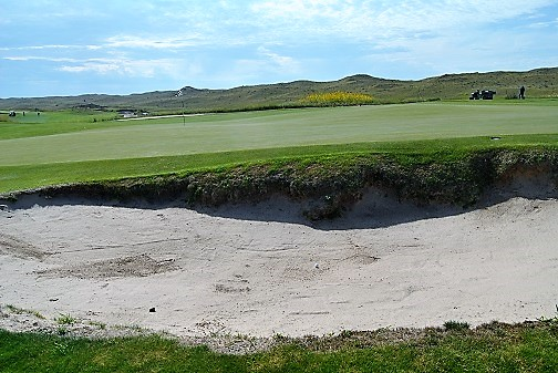 My approach shot landed in the green side bunker.