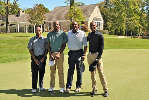 Charles, Michael, Kevin and me on the 18th green.