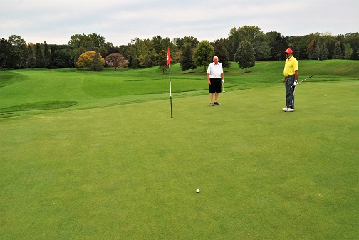 Leo and Ron help me with the line on my birdie putt.