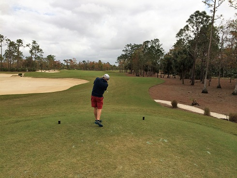 John hits his drive on the fifth hole