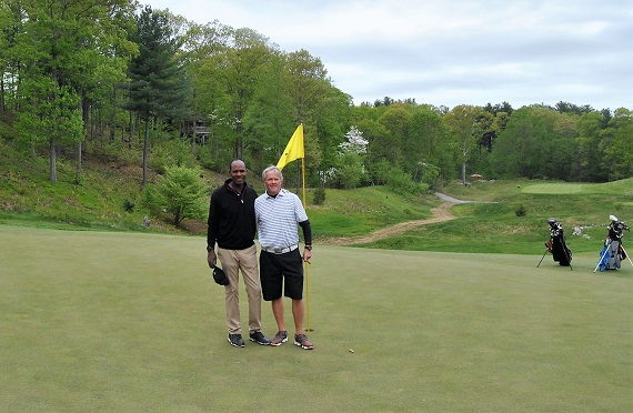 George and I on the 18th green following our round.