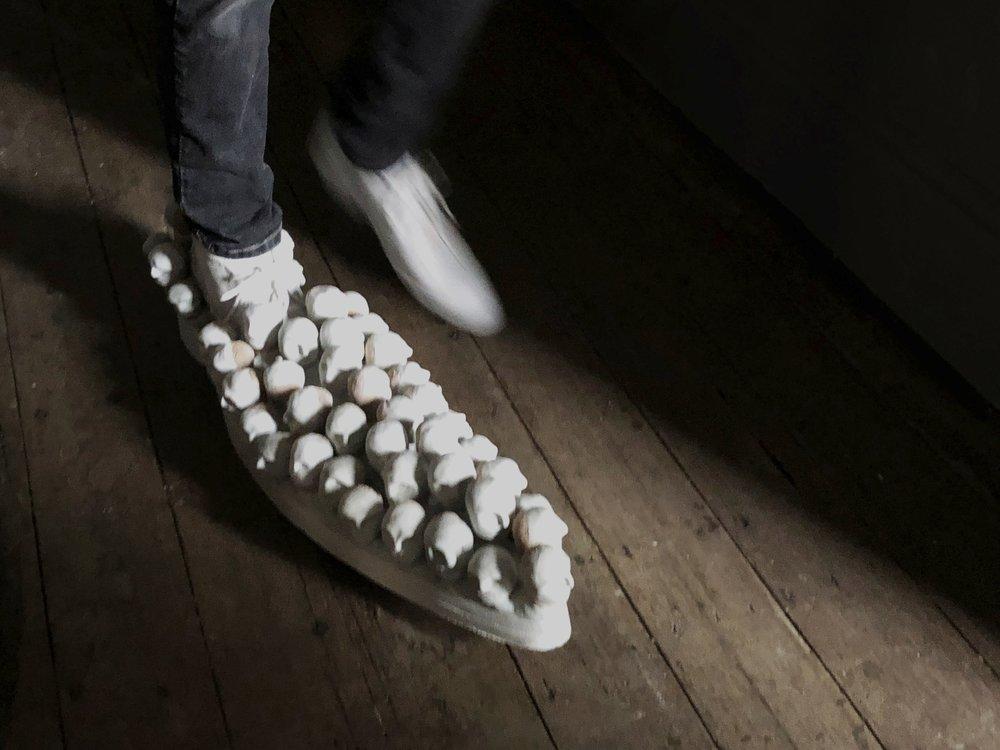 Heather B. Swann   The Shoemaker  2018  leather, cork, modelling compound, rubber, shellac, shoe laces  21 x 76 x 40 cm