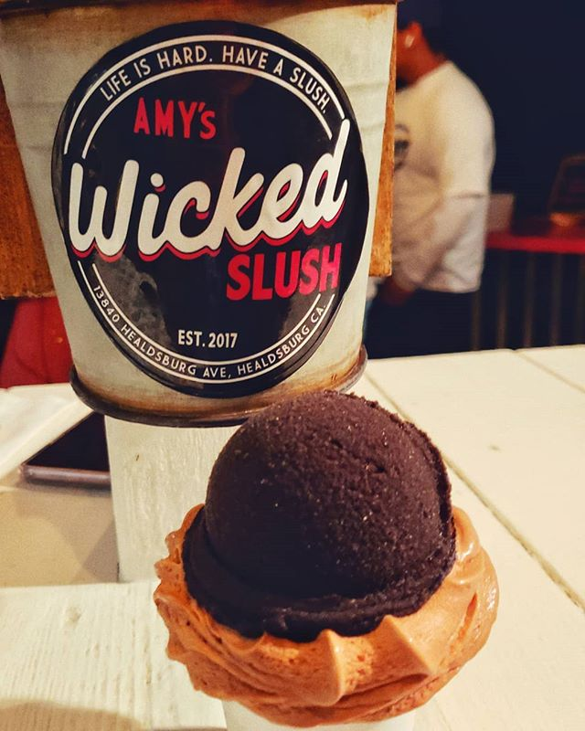 And on this hot night, we've been #blessed with @wickedslush.  Featuring black raspberry slush with chocolate soft serve ice cream.  #wickedslush #sonomacounty #dontbehangry #werehangrytravelers #phonephotography #misterdebs #softserve #slush #split #desserts #sweets #summerday #immelting #healdsburg #pipsqueak #refreshing