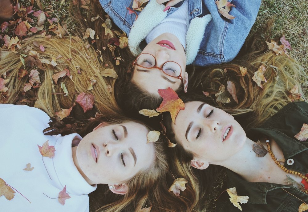 BPD-therapy-Melbourne-emptiness-and-BPD-young-women-lying-on-ground-together-with-closed-eyes