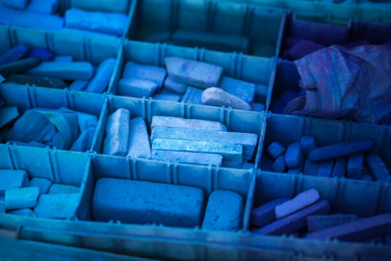 Blue art pastels in container. Art therapy for complex trauma helps people talk about their experiences without words. Art therapy helps us to discover our creativity.