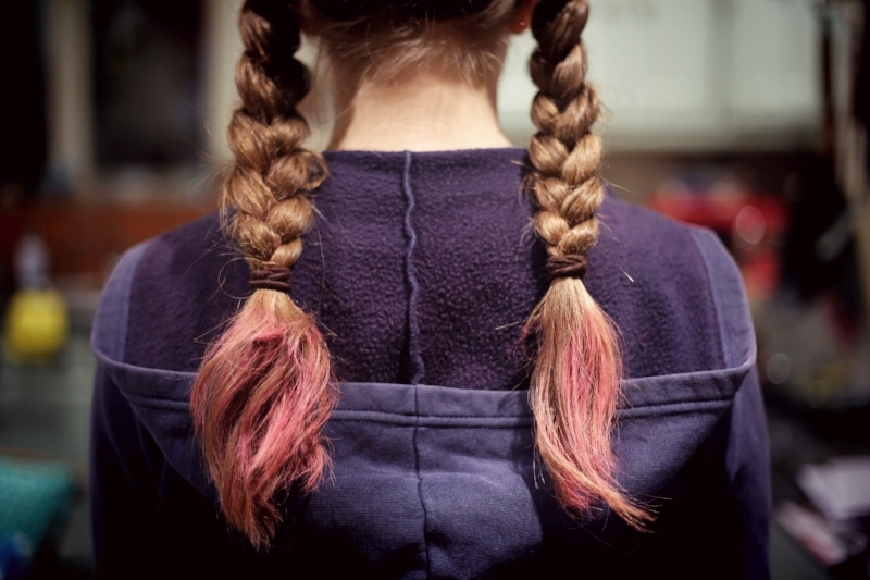 Trauma-counselling-and-therapy-Melbourne-young-girl-with-plaits-facing-away-from-camera