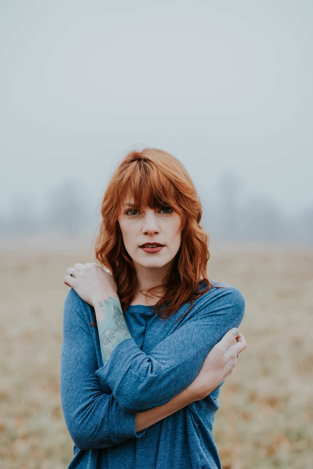 Girl-with-red-hair-wearing-blue-jumper