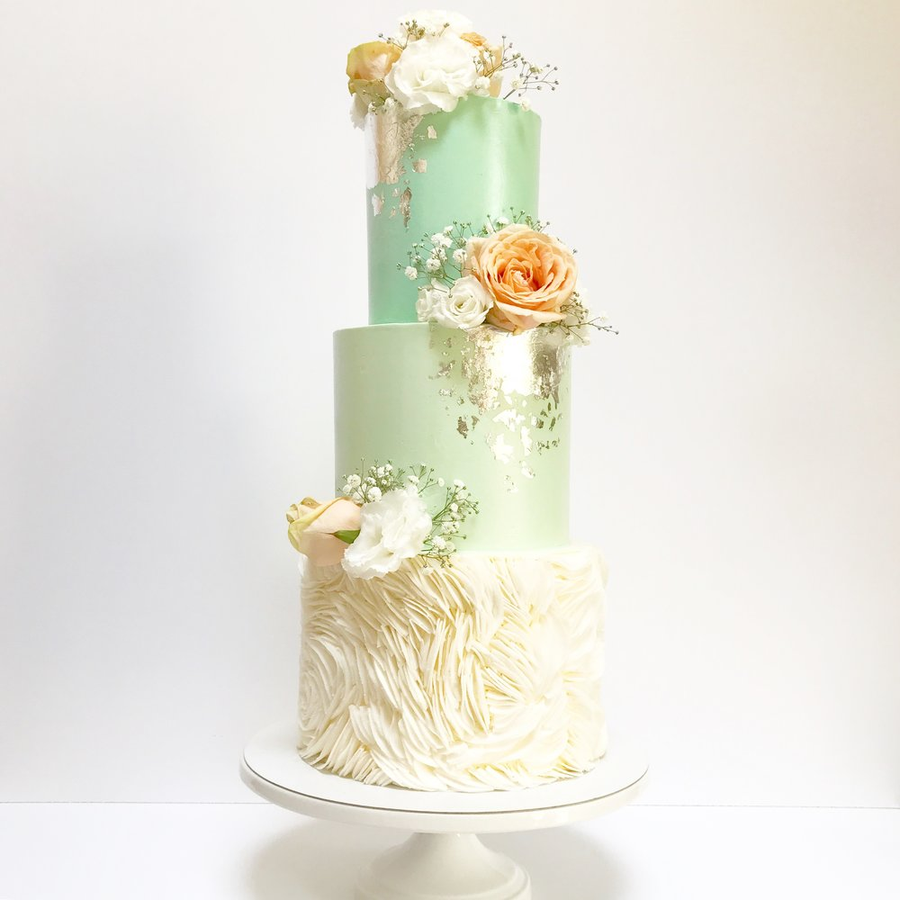 Mint green and coconut ruffles wedding cake.JPG
