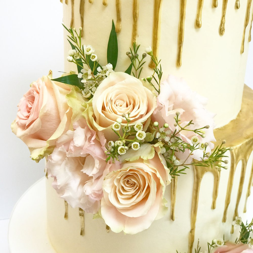 Blush flowers on gold drip cake.JPG