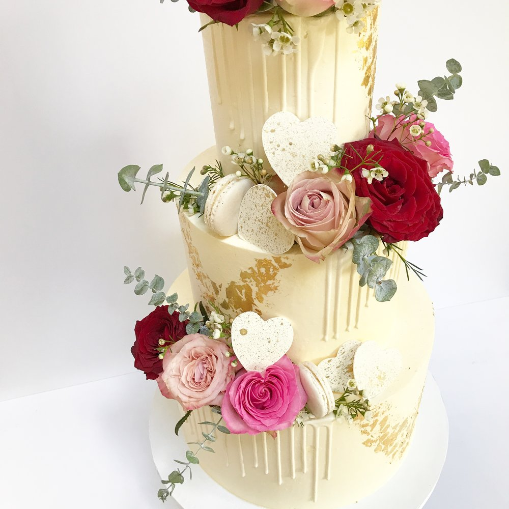 White on white drip buttercream cake.JPG