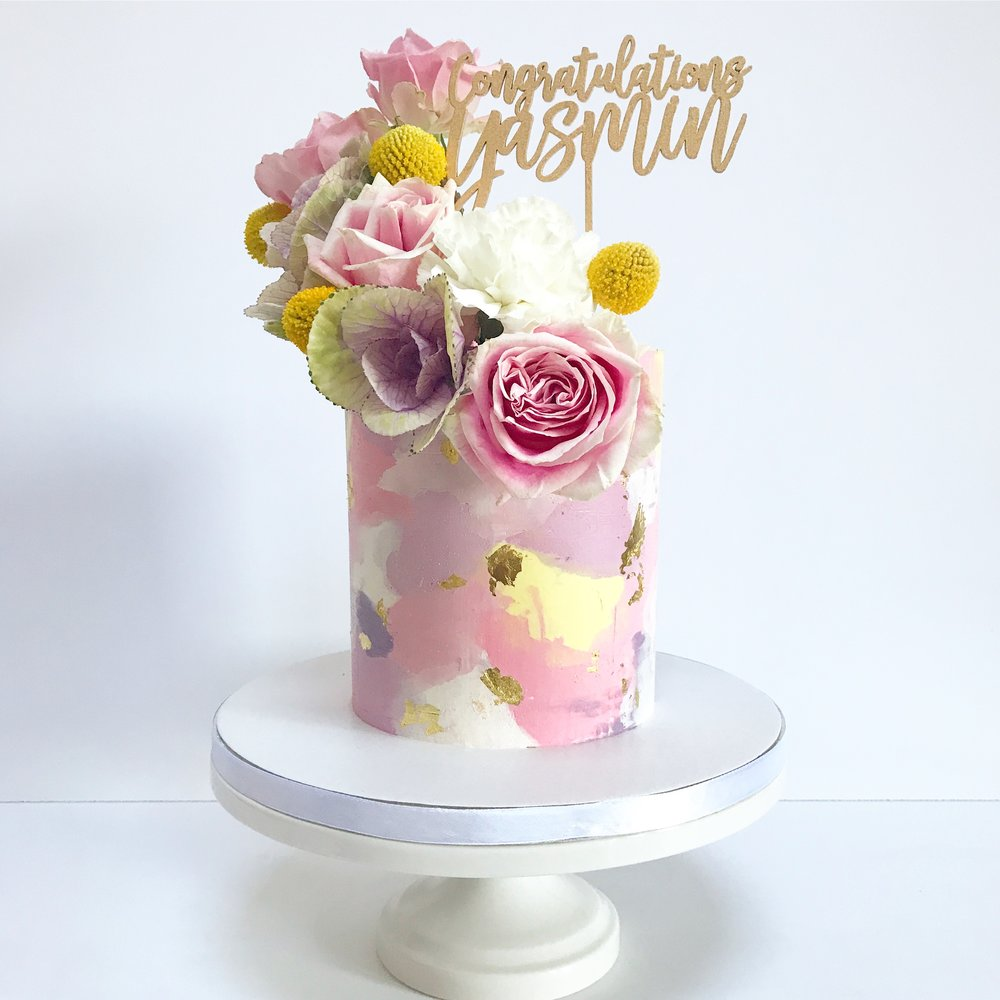Pink, mauve, purple and yellow buttercream cake.JPG