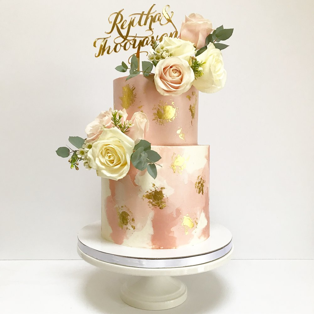 Blush and gold watercolour buttercream two tier wedding cake.JPG